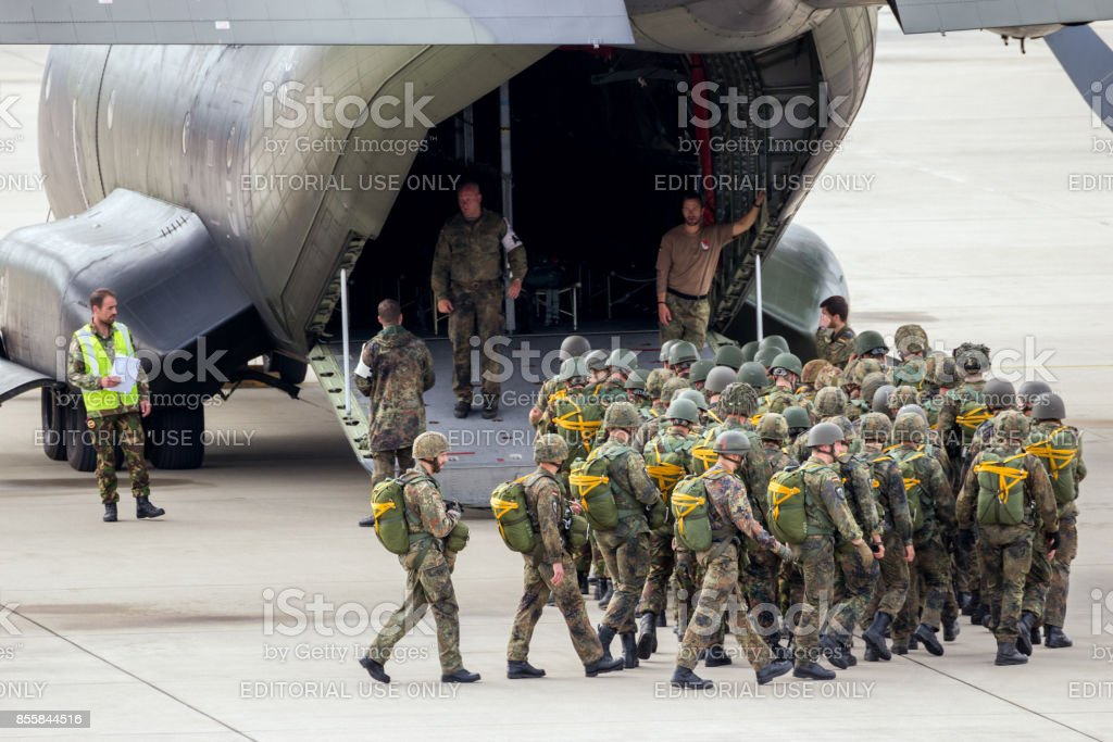 paratroopers entering a C-160 Transall plane stock photo