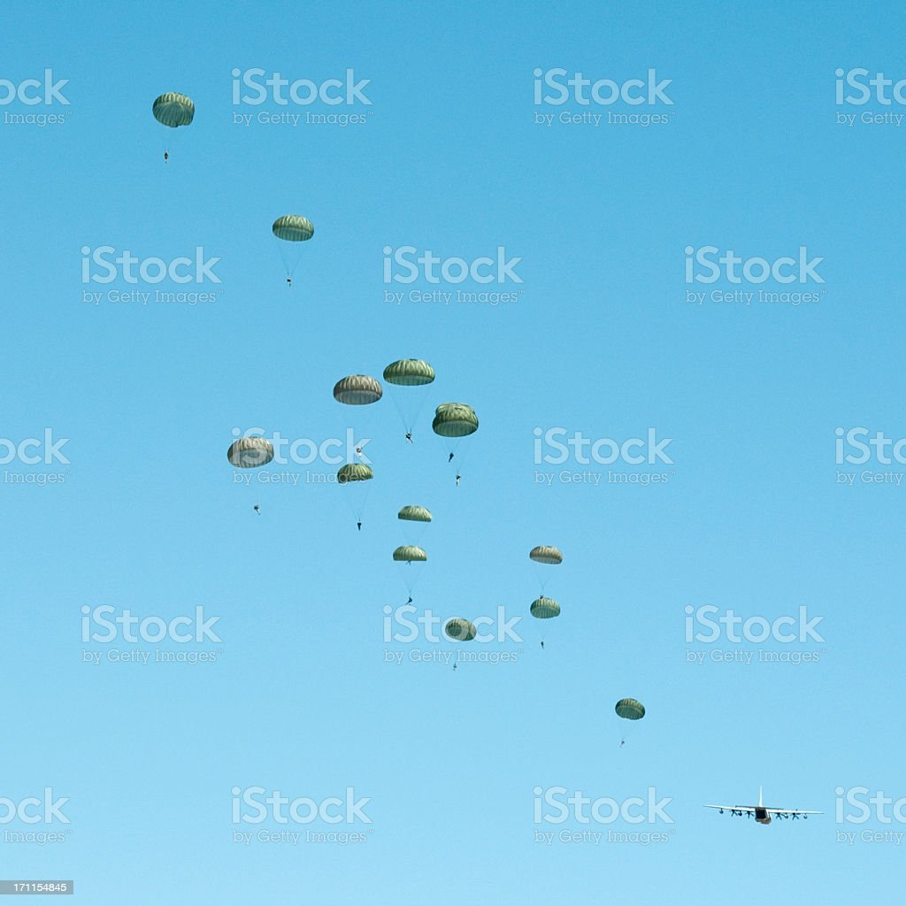 paratroopers jumping from C130 airplane stock photo