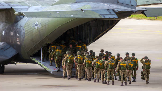 Paratroopers military plane EINDHOVEN, THE NETHERLANDS - SEP 17, 2016: Paratroopers entering a German Air Force C-160 Transall military airplane. trooper stock pictures, royalty-free photos & images
