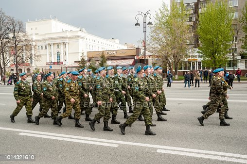 istock Paratroopers pass Tyumen columned down the street 1014321610