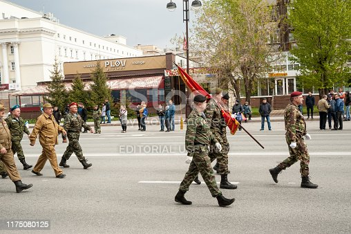 istock Paratroopers pass Tyumen columned down the street 1175080125