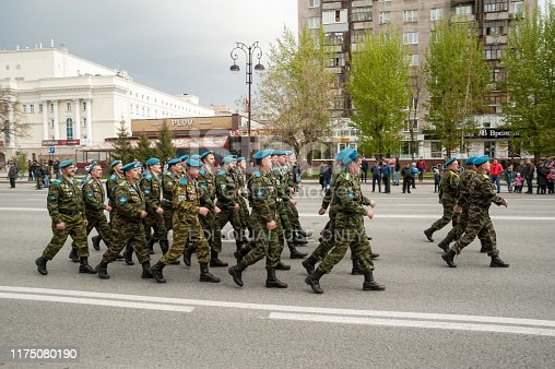 istock Paratroopers pass Tyumen columned down the street 1175080190