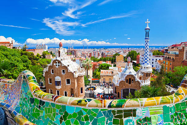 Parc Guell, Barcelona, Spain Parc Guell, Barcelona, Spain. Main entrance to Gaudi's Parc Guell and skyline of Barcelona. barcelona spain stock pictures, royalty-free photos & images