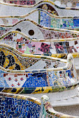 The world-famous bench of the Parc Guell designed and built by the spanish architect Antoni Gaudi in 1900-1914. The location is Barcelona, Spain.