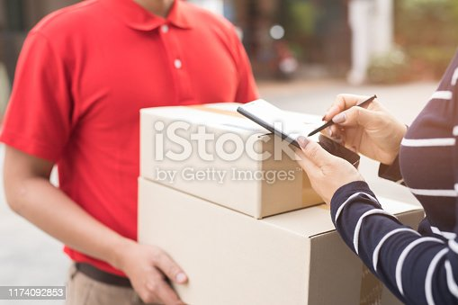 891482746istockphoto Parcel Delivery Officer 1174092853