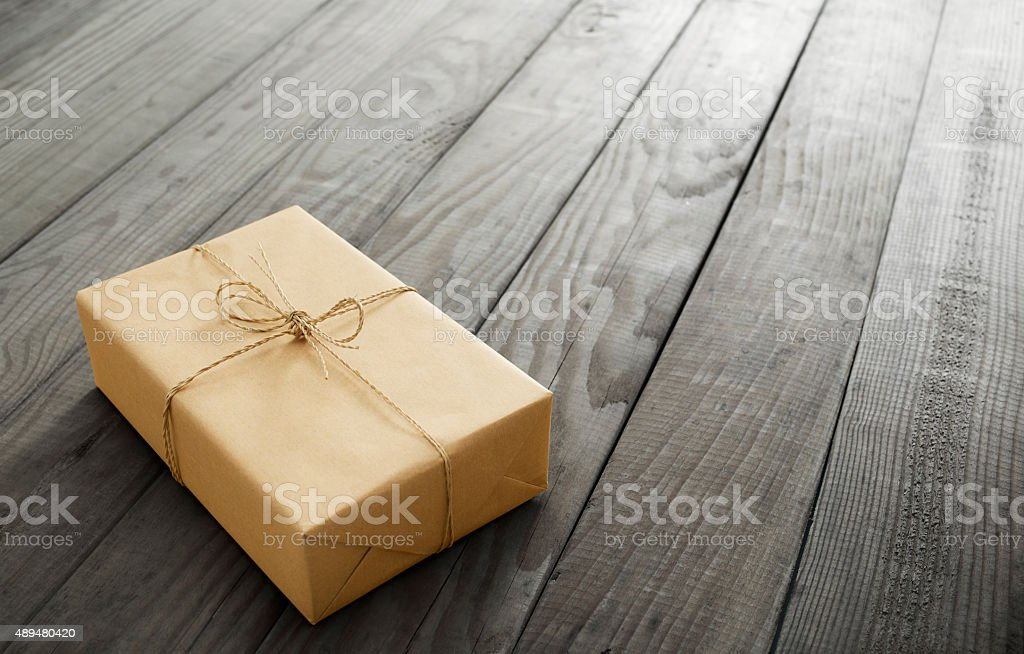 parcel on plank stock photo