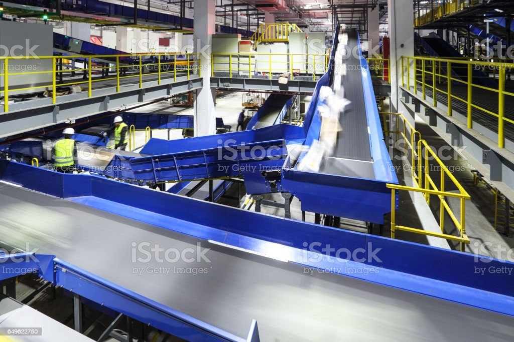 Parcel sorting through the production line stock photo