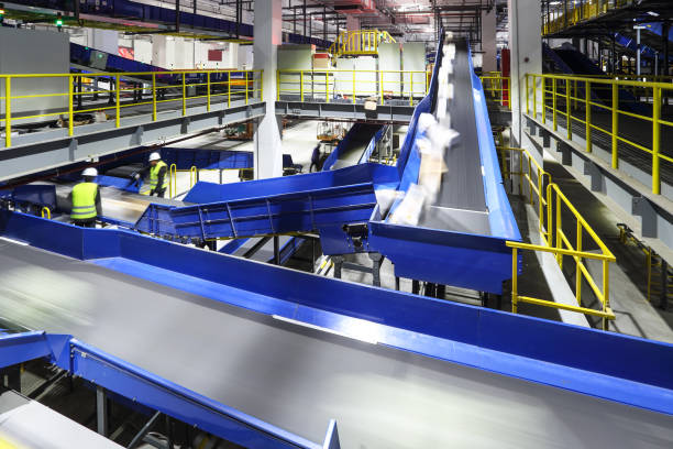 parcel sorting through the production line - conveyor belt stock photos and pictures