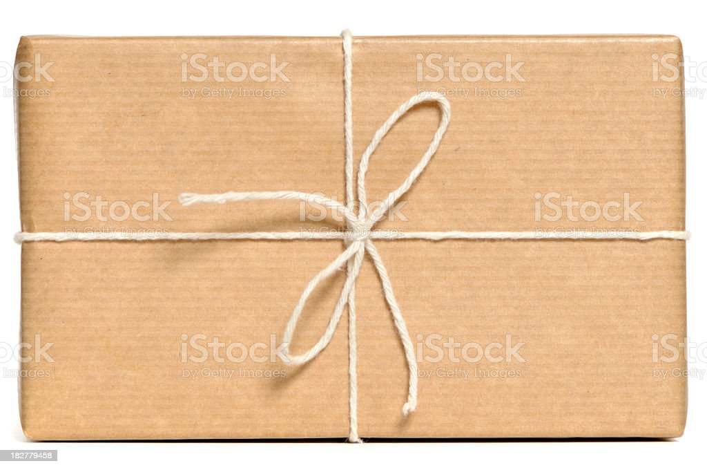 Parcel wrapped in brown paper and tied up with string  royalty-free stock photo