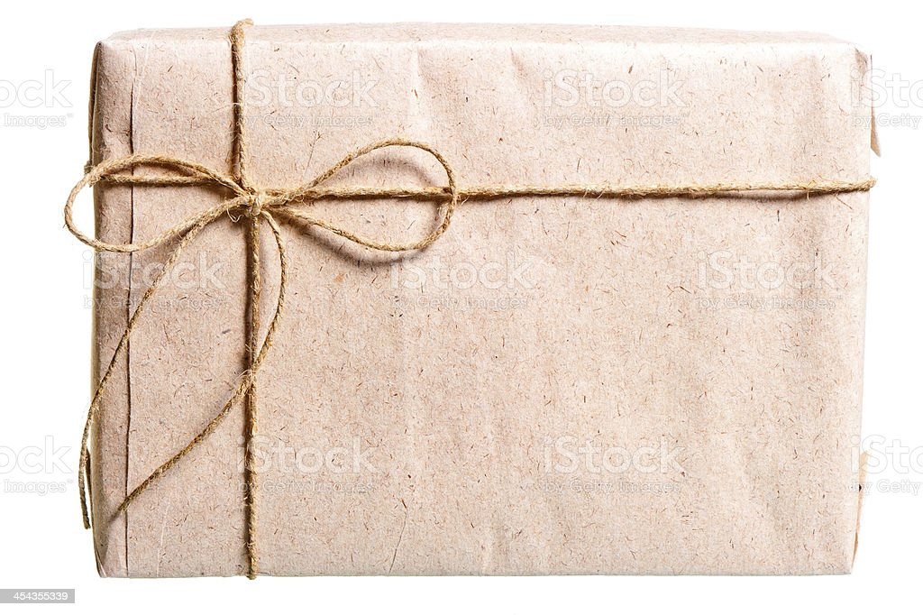 parcel wrapped in brown paper and tied with twine royalty-free stock photo