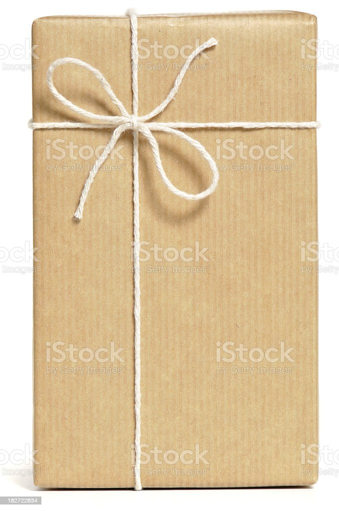 A parcel wrapped in brown paper and tied with white string royalty-free stock photo