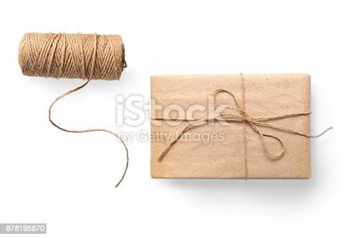 istock parcel wrapped packaged box gift and rope isolated on white background 878195870