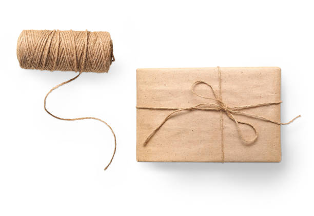 parcel wrapped packaged box gift and rope isolated on white background - avvolto foto e immagini stock