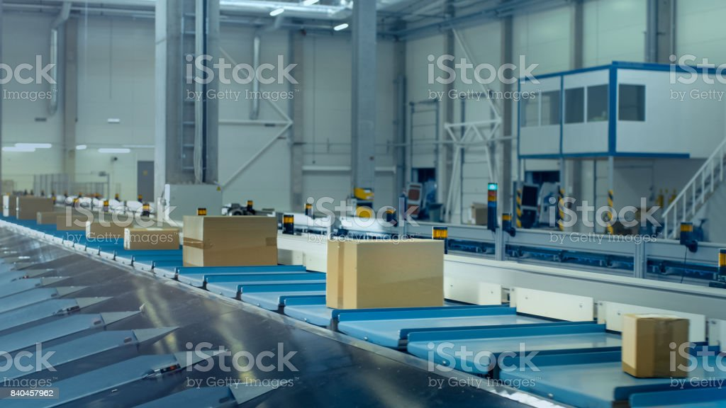 Parcels are Moving on Belt Conveyor at Post Sorting Office. stock photo
