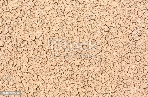 Parched and cracked earth at Badlands National Park in South Dakota.