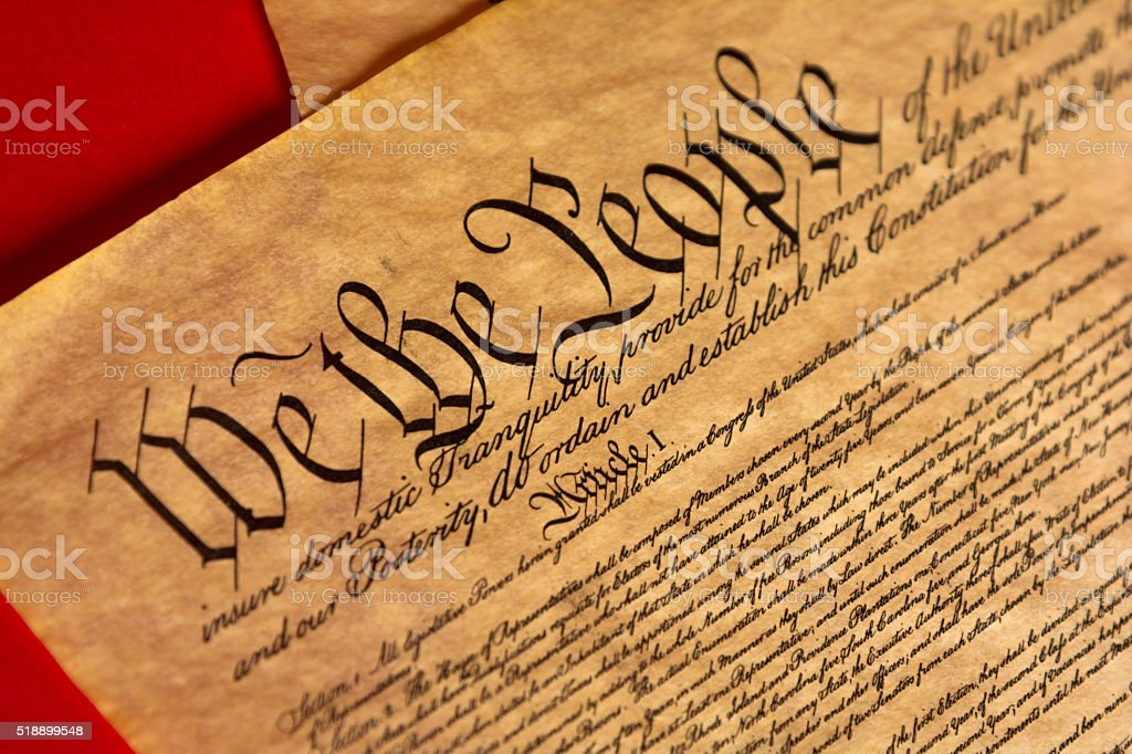 Parchment of the Constitution with a red background stock photo