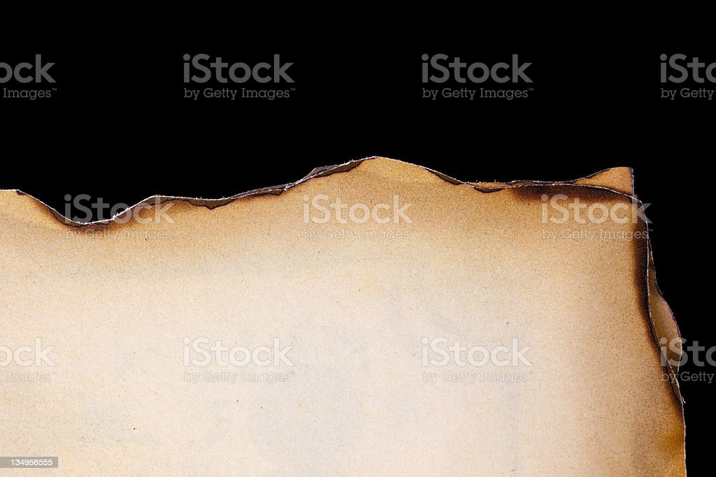 Parchment on black background. stock photo