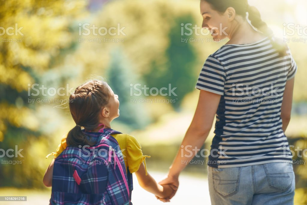 Parent and pupil go to school royalty-free stock photo
