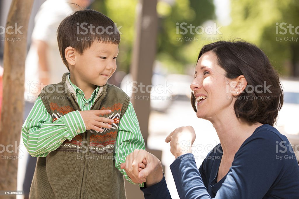Parent communicating with sign language stock photo