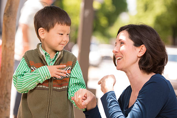 parent communicating with sign language - sign language stock photos and pictures