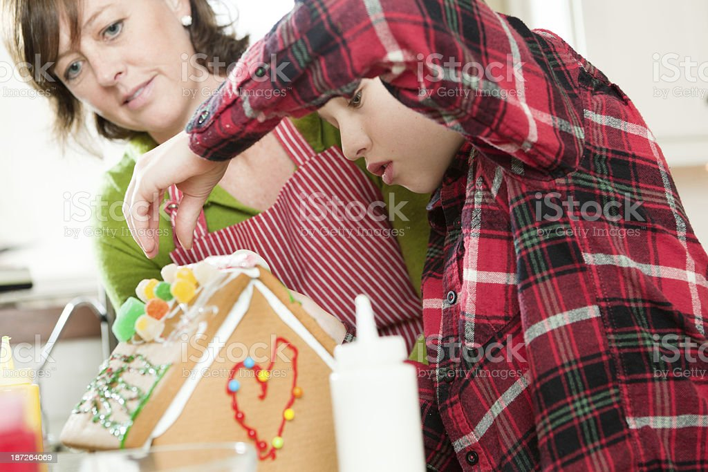 Parent Helping Children Building Christmas Gingerbread House Hz royalty-free stock photo