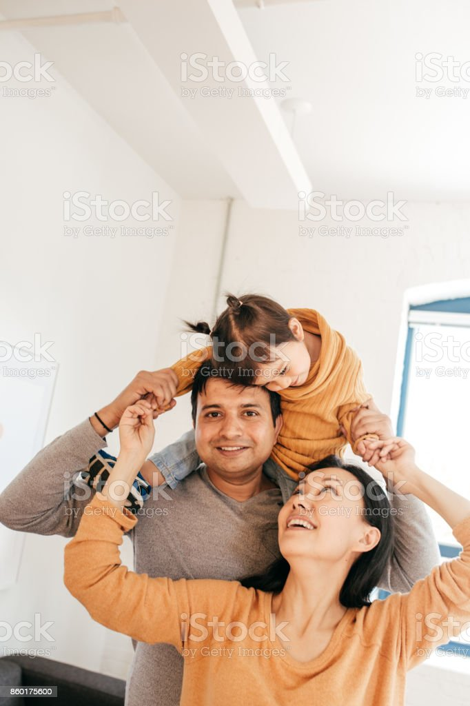 Parent playing with toddler stock photo