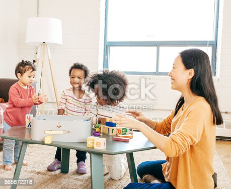 639403466istockphoto Parent playing with toddlers 865872218