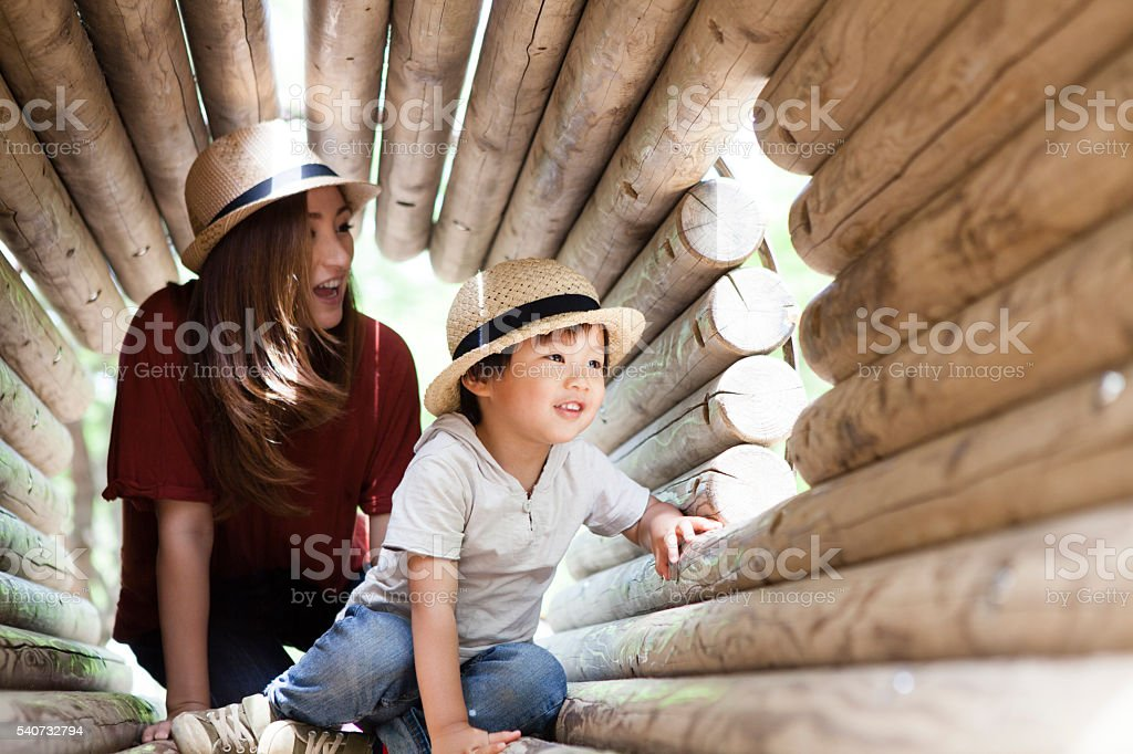 Parent-child playing with fun in the tunnel stock photo