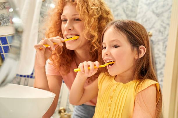 Parenthood concept mother and daughter standing at bathroom brushing picture id1215319001?b=1&k=6&m=1215319001&s=612x612&w=0&h=wknb zglpmzo5dxcs3sfhmvmptbzkcjgx7lryzjxkra=