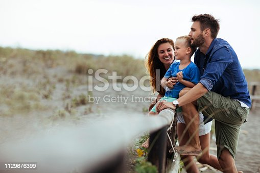 Young husband and wife with their child having a good time