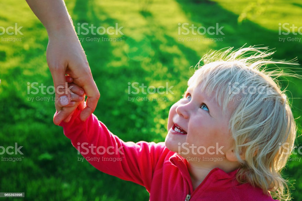parenting concept- mother holding hand of little daughter royalty-free stock photo