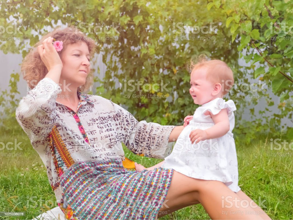 Parenting Concept Mother With Child On Her Knees Maternity Leave Background Stock Photo Download Image Now Istock