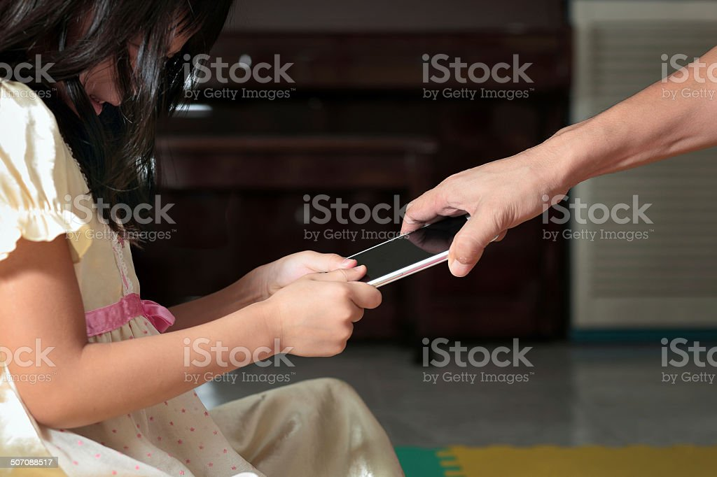 parenting in using smartphone stock photo