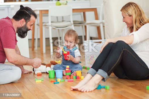 872316662 istock photo Parents and a little boy playing with toys 1134436931