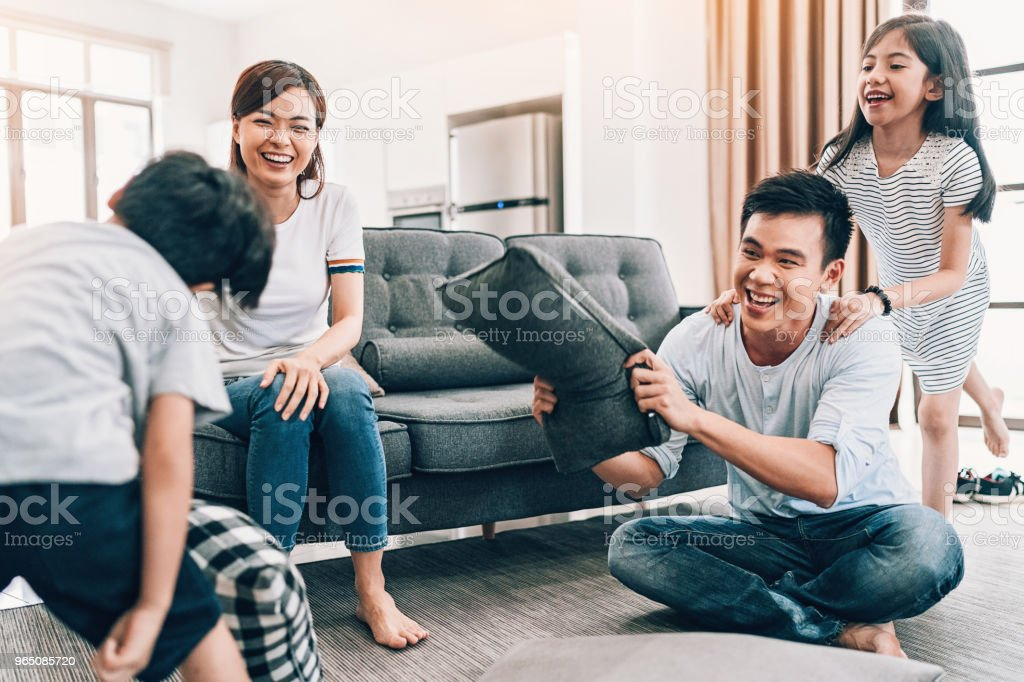 Parents and children playing together zbiór zdjęć royalty-free
