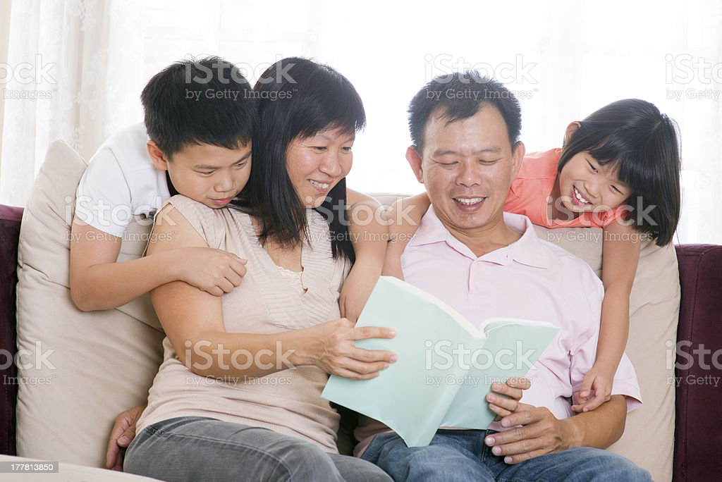 Parents and children reading books at home. royalty-free stock photo
