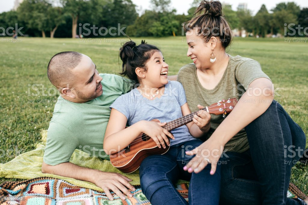 Parents and daughter on picnic stock photo