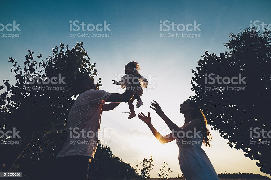 Parents and kid spending time stock photo