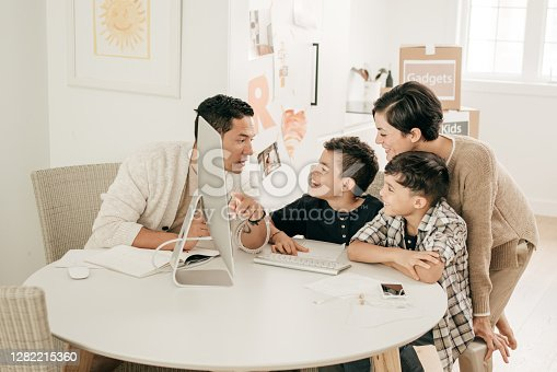 Parents and kids at home with online lecture