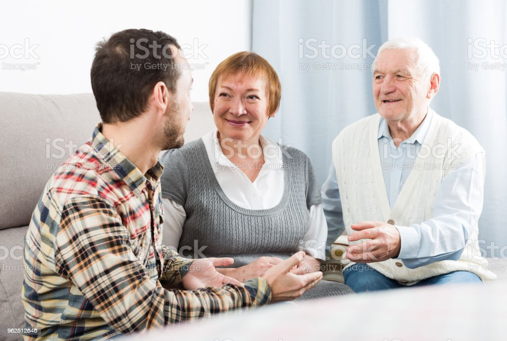 Parents and son enjoying evening - Royalty-free Adult Stock Photo