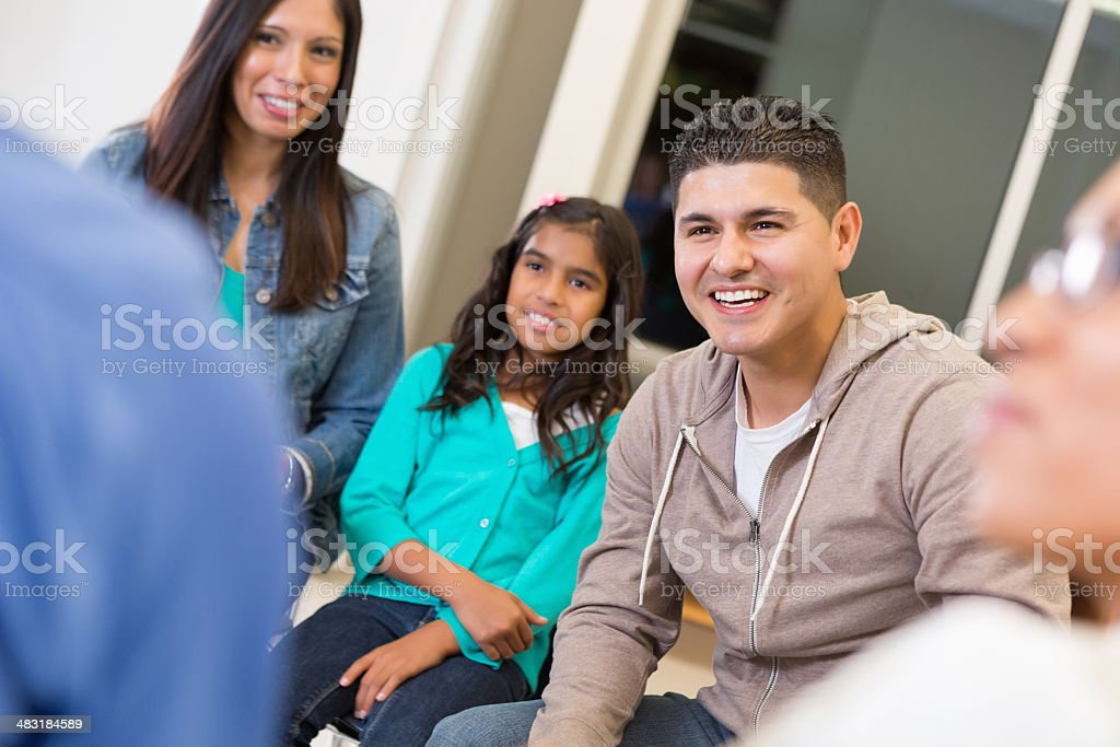 Parents and teachers meeting with students at elementary school stock photo