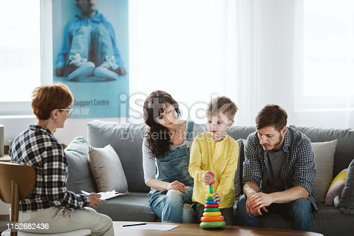 istock Parents and therapist are sitting on the couch during a meeting about their child 1152682436