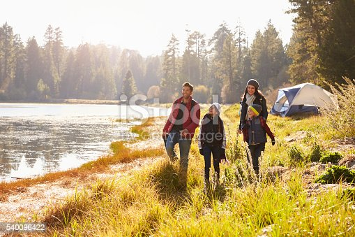 istock Parents and two children on camping trip walking near 540096422