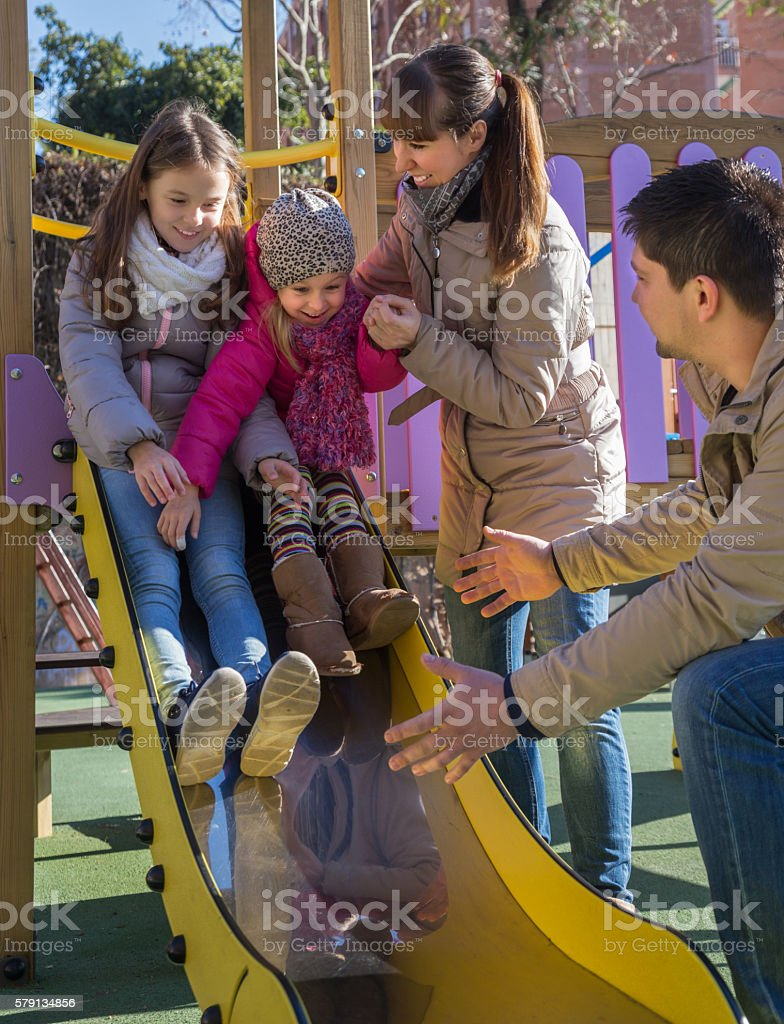 Parents and two daughters at playground – Foto