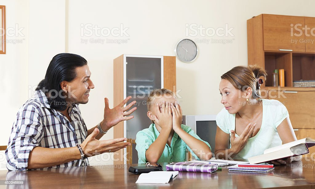 Parents berates her underachiever son stock photo