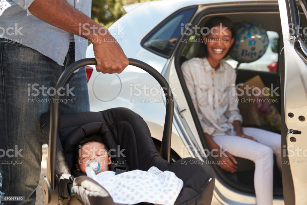 Parents Bringing Newborn Baby Home In Car stock photo