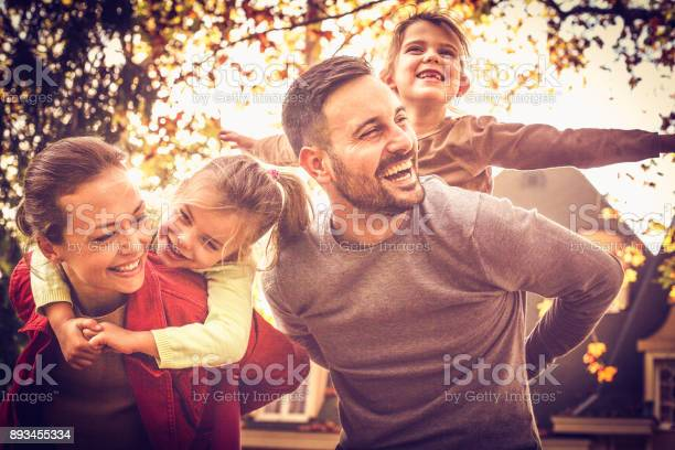 Parents carrying little girls on piggyback family time picture id893455334?b=1&k=6&m=893455334&s=612x612&h=f33gikqucwhorfm9q2z2zpihiiljyfoglhbpwdzxdhy=