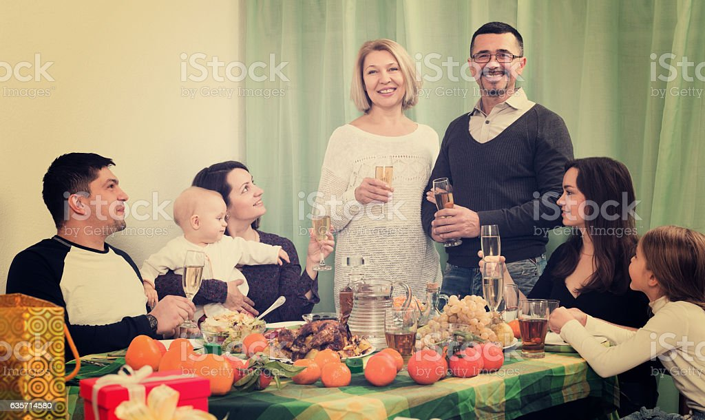 Parents, children and grandparents togethe congratulating royalty-free stock photo