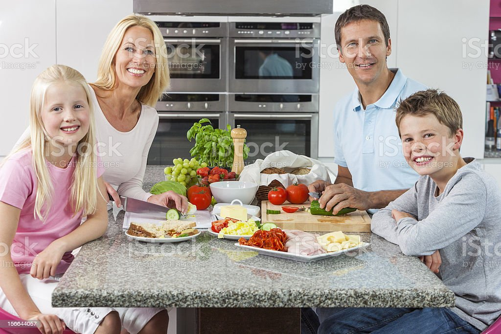 Parents Children Family Preparing Healthy Food stock photo