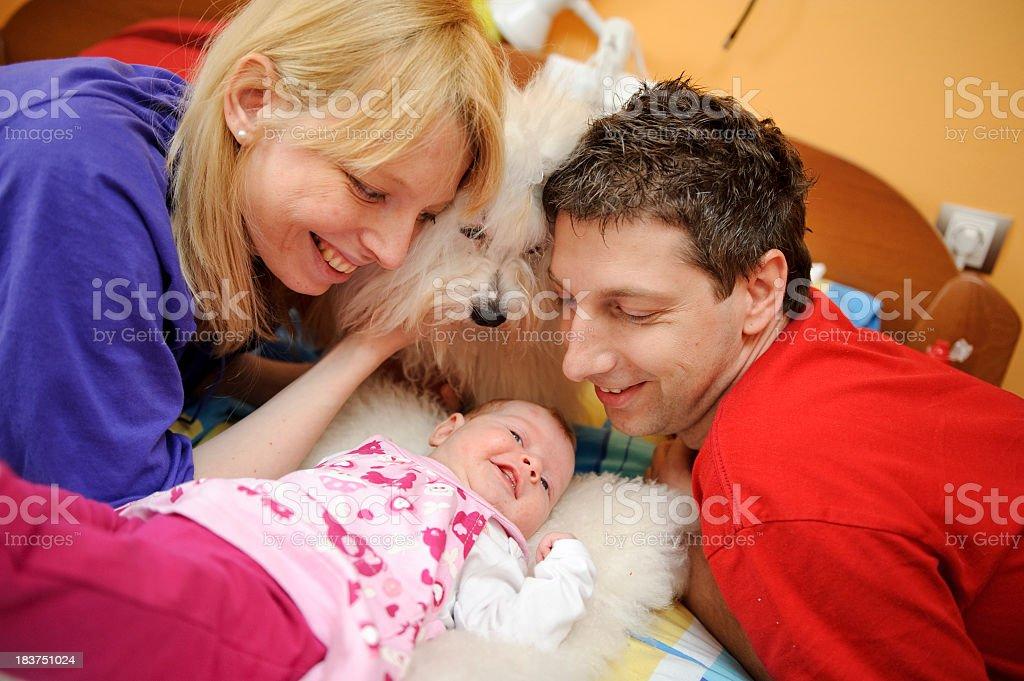 Parents Cuddling Newborn Baby Girl royalty-free stock photo